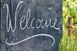 A Welcome board for a garden party