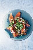 Salmon ceviche with avocado and sesame seeds