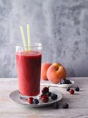 A watermelon and blueberry smoothie with gooseberries and peaches