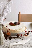Cake with figs on table with Christmas decorations