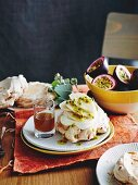 Macadamia meringues with banana, passionfruit and lemon myrtle syrup