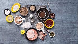 An arrangement of various types of salt and pepper (seen from above)