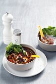 Spicy broth with peppers, vegetables and beef (Asia)