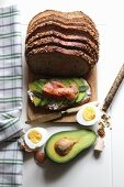 Bread topped with avocado, smoked salmon and hard-boiled egg