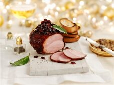Ham with Christmas pudding and toast on a chopping board