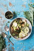 Baked kale salad with roasted sweet potatoes, spicy baked chickpeas and fresh pear
