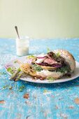 Grilled steak burger with chargrilled pears and a wholegrain mustard and blue-cheese sauce