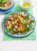 Grilled peach salad with proscuitto and blue cheese
