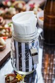 Jar with a whistle as a napkin holder