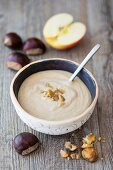 A smoothie bowl with chestnuts and apple