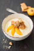 A smoothie bowl wth yellow plums and buttery biscuits