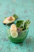 A smoothie bowl with spinach, avocado and banana