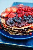 Pancake cake with jam and fresh berries