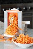 Carrots being cut into spirals