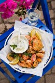 Fried herbs and tomatoes with tzatziki