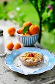 Apricot tartlet with raspberries on a summer table outside