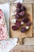 Beetroot with a salt crust on a chopping board