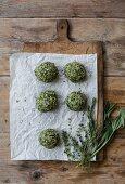 Spinach dumplings on a chopping board