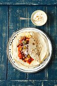 Tortilla with minced turkey, kidney beans, tomatoes, jalapeños and yoghurt