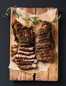 Porterhouse and sirloin steaks on a wooden board