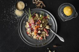 Strawberry millet risotto with spring vegetables and grasshoppers