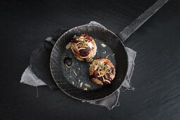 Goat's cheese vol-au-vents with lingoberries and crispy meal worms