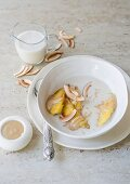 Fried bananas in a coconut and vanilla soup with a nut butter and honey sauce