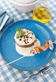 Sea eels and a seafood kebab with garlic sauce