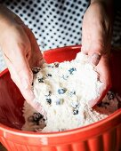 Blueberry scone dough being kneaded