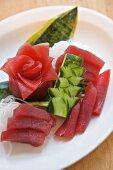 Tuna sashimi with artistically cut daikon radish and cucumber