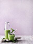 A green smoothie with grapefruit, avocado, young spinach and mint