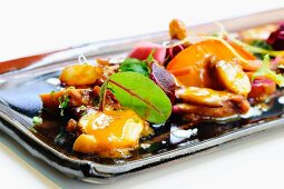 Seafood salad with octopus and beetroot