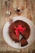 Gluten-free chocolate cake with raspberries