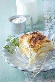 A serving of potato gratin with creme fraiche