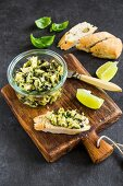 Artichoke and olive tapenade with wedges of lime and bread