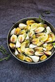 Fried baby artichokes with spring onions and lemon