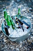 Beer and mineral water bottles in an ice bucket