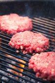 A hamburger on a grill