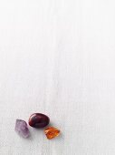 An agate, an amethyst and amber
