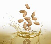 Peanuts falling into oil