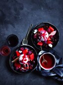 Watermelon fruit salad with ice-cream and raspberry-pepper syrup