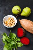 Ingredients for oven cooked vegetables: pears, chick peas, sweet potato, spinach, beetroot (Vegan)