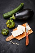 Ingredients for marinated zucchini slices with tofu and fried aubergine