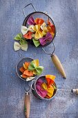 Colorful farfalle pasta in a colander