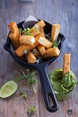 Deep fried halloumi sticks with avocado cream