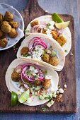 Soft tacos with avocado and falafel