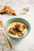 Creamy root vegetable soup with mushroom crostini
