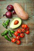 Vegan ingredients: sweet potato, red onions, cocktail tomatoes, Pimientos De Padron and avocado