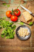 Ingredients for tomato-infused barley risotto with tofu and spinach