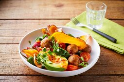 Vegan chickpea balls with fried sweet potatoes, cherry tomatoes and avocado